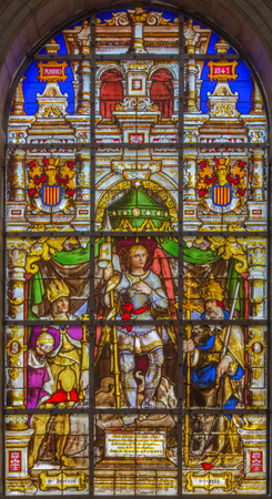 BRUSSELS, BELGIUM - JUNE 16, 2014: Stained glass window depicting the Archangel Gabriel in the center (1843) in the cathedral of st. Michael and st. Gudula.