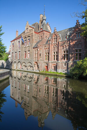 mirro: Bruges - Look from Dijver street to canal with the mirror of typically brick houses.