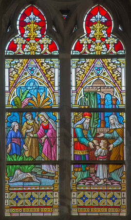 religiosity: BRUGES, BELGIUM - JUNE 12, 2014: Scenes The Presentation of Jesus in the Temple and The Moses rescued from the Nile st. Joseph on windwopane in st. Jacobs church (Jakobskerk) by J. Dobbelare (1901). Editorial