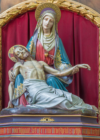 BRUGES, BELGIUM - JUNE 12, 2014: The neo-gothic carved Pieta in st. Jacobs church (Jakobskerk).