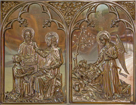 giles: BRUGGE, BELGIUM - JUNE 13, 2014: The Miracle Miracle of Multiplying Food and the Angel give the bread to prophet Elijah scene. Neogothic metal relief in st. Giles (Sint Gilliskerk).