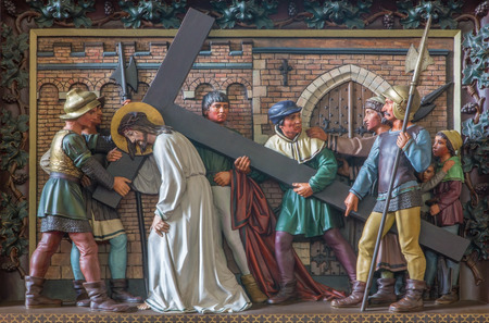 giles: BRUGES, BELGIUM - JUNE 13, 2014:  Simon of Cyrene help Jesus to carry his cross. Relief in st. Giles church (Sint Gilliskerk) as part of the Passion of Christ cycle. Editorial