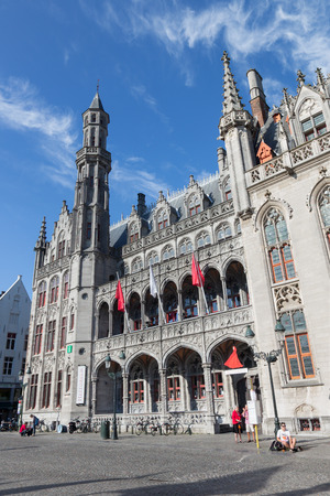neo gothic: BRUGES, BELGIUM - JUNE 13, 2014: Neo gothic facade of Historium builidnig from years 1910-1914 on the Grote Markt square.