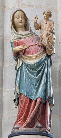 polychrome: The carved and polychrome statue of gothic Madonna from 14. cent. in church Our Lady across de Dyle. Stock Photo