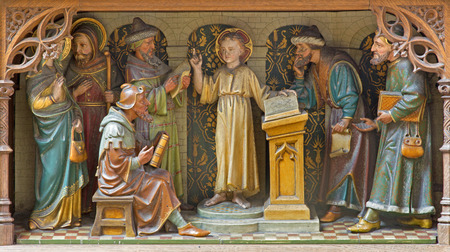 Carved sculptural group - Boy Jesus teaching in the Temple scence on the new gothic side altar of church Our Lady across de Dyle.