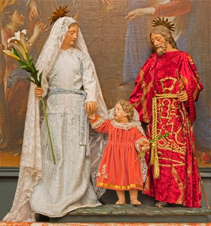 BRUSSELS, BELGIUM - JUNE 16, 2014: The Holy family in the dress in church Eglise de St Jean et St Etienne aux Minimes.