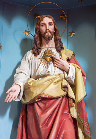SEBECHLEBY, SLOVAKIA - JULY 27, 2014: The carved statue of Heart of Jesus Christ from 19. cent. Editorial