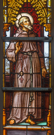 BRUSSELS, BELGIUM - JUNE 16, 2014: Saint Francis of Assisi on windwopane from 19. cent. in the cathedral of st. Michael and st. Gudula.