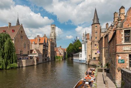BRUGES, BELGIUM - JUNE 13, 2014: View from the Rozenhoedkaai in Brugge with the Perez de Malvenda house and Belfort van Brugge in the background.