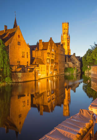 belfort: Bruges - View from the Rozenhoedkaai in Brugge with the Perez de Malvenda house and Belfort van Brugge in the background in the evning dusk.