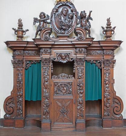 god box: BRUGES, BELGIUM - JUNE 13, 2014: The carved confession box in Karmelietenkerk (Carmelites church) by carmelite Victor van de Heilige Jacob fromk 17. cent. Editorial