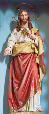 SEBECHLEBY, SLOVAKIA - JULY 27, 2014: The carved statue of Heart of Jesus Christ from 19. cent. Editoriali