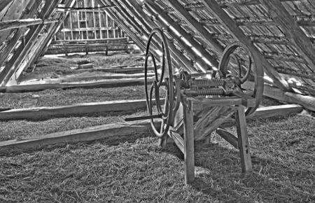 billet: old chaff machine on the billet of village house in Slovakia