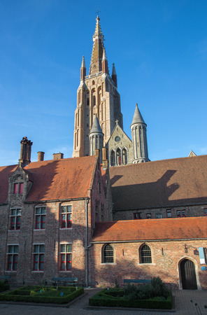 sint: Bruges - Church of Our Lady from yard of Saint John Hospital (Sint Janshospitaal) in evening light