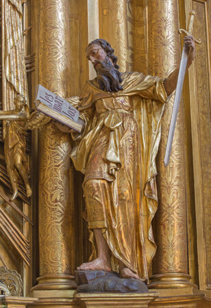 TRNAVA, SLOVAKIA - MARCH 3, 2014: The polychrome statue of saint Paul the apostle in the Jesuits church.