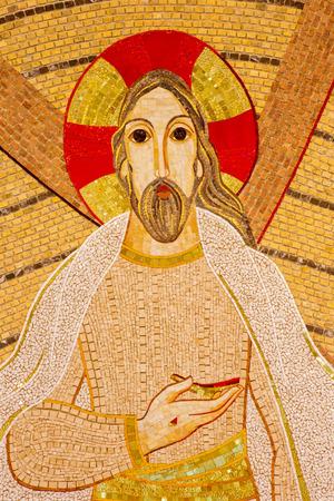 BRATISLAVA , SLOVAKIA - OCTOBER 1, 2014_ The detail of mosaic of resurrected Christ  in the Saint Sebastian cathedral designed by jesuit Marko Ivan Rupnik (2011).