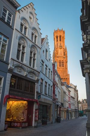 belfort: BRUGES, BELGIUM - JUNE 12, 2014: The tower of Belfort van Brugge in the morning light from Breidelstraat Editorial