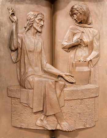 PADUA, ITALY - SEPTEMBER 9, 2014: The Modern metal relief on the pulpit  in church Santa Maria dei Servi. Jesus and the Samaritan woman at the well by R. Czemesini (1988)