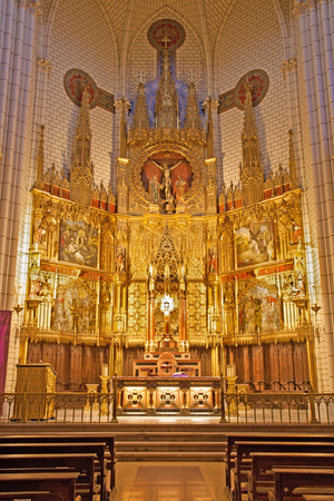 neogothic: MADRID - MARCH 9: Main carved neo-gothic altar of church Santa cruz on March 9, 2013 in Spain.