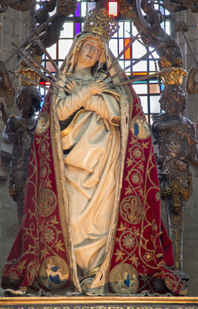 the church of our lady: MECHELEN, BELGIUM - JUNE 14, 2014: The carved statue of the Lady of Sorrow in the coat in church Our Lady across de Dyle.