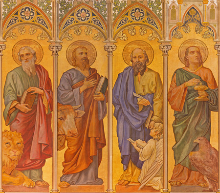 TRNAVA, SLOVAKIA - OCTOBER 14, 2014: The neo-gothic fresco of four  evangelists (Mark,Luke,Matthew,John) by Leopold Bruckner (1905 - 1906) in Saint Nicholas church. 新聞圖片