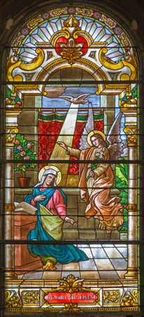 annunciation of mary: TRNAVA, SLOVAKIA - OCTOBER 14, 2014: The annunciation in baroque windowpane in St. Nicholas church and Virgin Mary chapel.