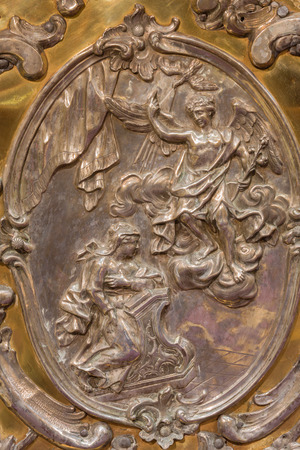 angel gabriel: TRNAVA, SLOVAKIA - OCTOBER 14, 2014: The metal relief of the Annunciation on the altar in Virgin Mary chapel designed by A. Huetter (1739 – 1741) in St. Nicholas church.