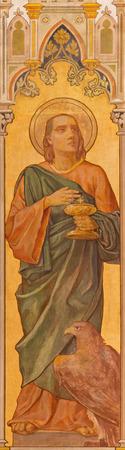 TRNAVA, SLOVAKIA - OCTOBER 14, 2014: The neo-gothic fresco of st. John the evangelist by Leopold Bruckner (1905 - 1906) in Saint Nicholas church.