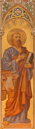 TRNAVA, SLOVAKIA - OCTOBER 14, 2014: The neo-gothic fresco of st. Luke the evangelist by Leopold Bruckner (1905 - 1906) in Saint Nicholas church. Editorial