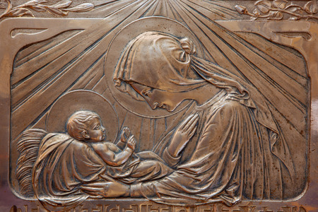 TRNAVA, SLOVAKIA - OCTOBER 14, 2014: The metal secession relief of Madonna with the child in Virgin Mary chapel in St. Nicholas church by unknown artist. Editorial