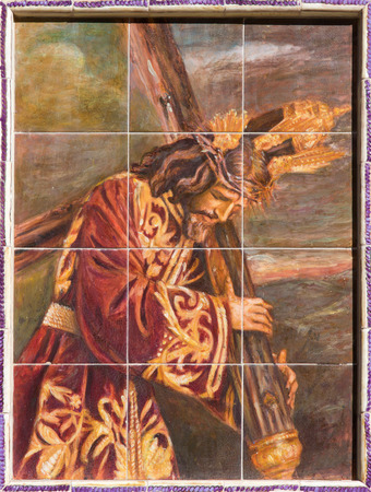 SEVILLE, SPAIN - OCTOBER 27, 2014: The ceramic tiled Christ with the cross by artist Enrique Orce Marmol on the church Iglesia San Roque. Editorial