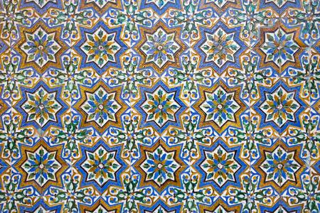 mudejar: SEVILLE, SPAIN - OCTOBER 28, 2014: The detail of tiles in mudejar style in courtyard of Casa de Pilatos.