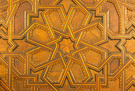 SEVILLE, SPAIN - OCTOBER 28, 2014: Detail from mudejar wood gate in church Iglesia de San Pedro.