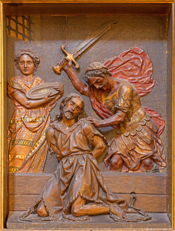 baptist: SEVILLE, SPAIN - OCTOBER 29, 2014: The carved polychrome relief of decapitation of  St. John the Baptist in church Iglesia de la Anunciacion by Martinez Montanes from 18. cent. Editorial