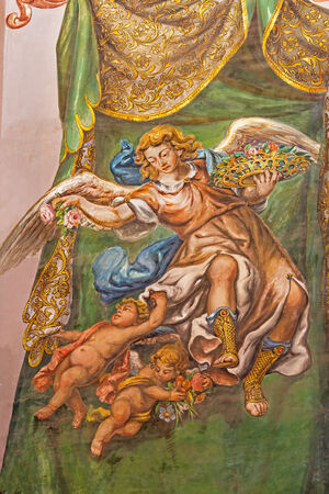 SEVILLE, SPAIN - OCTOBER 28, 2014: The fresco of angel with the roses in church Hospital de los Venerables Sacerdotes by Juan de Valdes Leal (1622 - 1690).