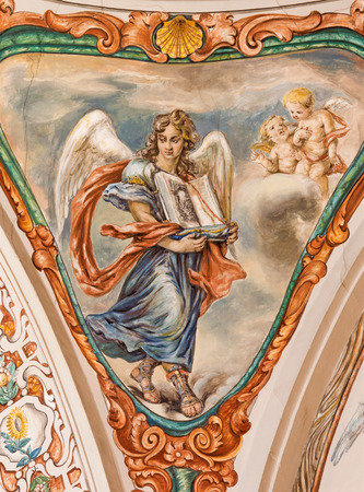 SEVILLE, SPAIN - OCTOBER 28, 2014: The baroque fresco of angel with the liturgy book in church Hospital de los Venerables Sacerdotes  by Juan de Valdes Leal (1622 - 1690).