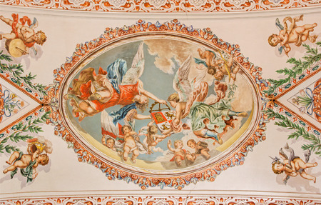 SEVILLE, SPAIN - OCTOBER 28, 2014: The fresco of angels with the symbolic crown on the ceiling in church Hospital de los Venerables Sacerdotes  by Juan de Valdes Leal (1622 - 1690).