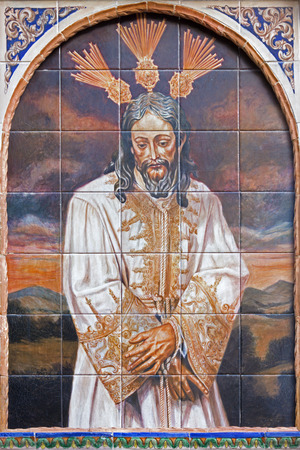 marmol: SEVILLE, SPAIN - OCTOBER 29, 2014: The ceramic tiled Christ in the bond by from 20. cent. by artist Enrique Orce Marmol on the facade of church Iglesia San Juan de la Palma.
