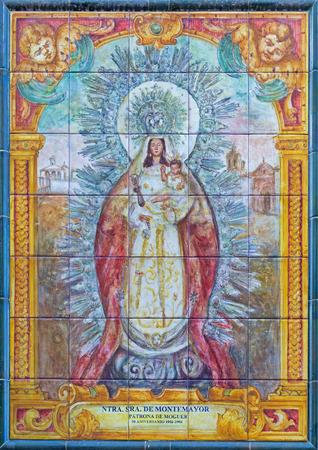 marmol: SEVILLE, SPAIN - OCTOBER 29, 2014: The ceramic tiled Madonna (Nuestra Senora de Montemayor) from 20. cent. by artist Enrique Orce Marmol on the facade of church Iglesia San Juan de la Palma.