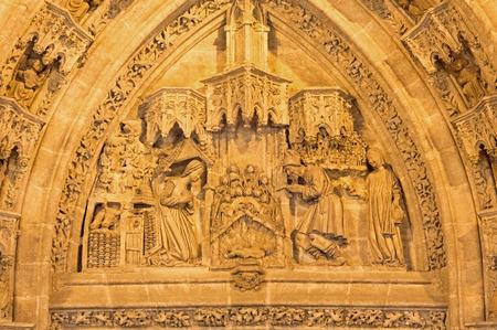 nativity scene: SEVILLE, SPAIN - OCTOBER 28, 2014: The Nativity scene on the Puerta San Miguel on the  Cathedral de Santa Maria de la Sede by Nicolas Martinez y Juan Norman from 15. cent.