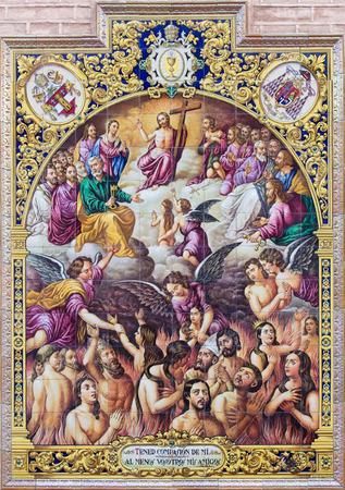 san pedro: SEVILLE, SPAIN - OCTOBER 28, 2014: The ceramic tiled Last judgment scene by Ramos Resano on the facade of church Iglesia de San Pedro. Editorial