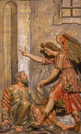 polychrome: SEVILLE, SPAIN - OCTOBER 28, 2014: The carved polychrome relief of the scene Liberation Of Saint Peter on the main altar in church Iglesia de San Pedro by Felipe de Ribas (1641 - 1657). Editorial