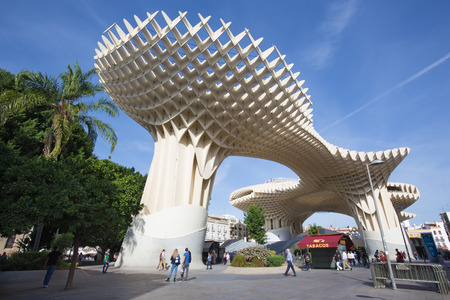 metropol parasol: SEVILLE, SPAIN - OCTOBER 28, 2014: Metropol Parasol wooden structure located at La Encarnacion square, designed by the German architect Jurgen Mayer-Hermann and completed in April 2011. Editorial