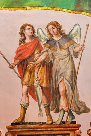 SEVILLE, SPAIN - OCTOBER 28, 2014: The baroque fresco of archangel Raphael and Tobias in church Hospital de los Venerables Sacerdotes by Juan de Valdes Leal (1622 - 1690).