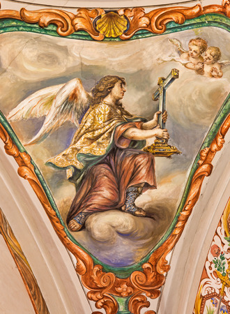 SEVILLE, SPAIN - OCTOBER 28, 2014: The baroque fresco of angel with the symbolic cross in church Hospital de los Venerables Sacerdotes  by Juan de Valdes Leal (1622 - 1690).