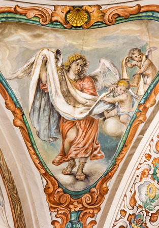 SEVILLE, SPAIN - OCTOBER 28, 2014: The baroque fresco of angel with the vestment in church Hospital de los Venerables Sacerdotes  by Juan de Valdes Leal (1622 - 1690).