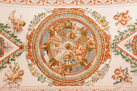 in ceiling: SEVILLE, SPAIN - OCTOBER 28, 2014: The fresco of angels with the insignia of pope on the ceiling in church Hospital de los Venerables Sacerdotes by Juan de Valdes Leal (1622 - 1690).