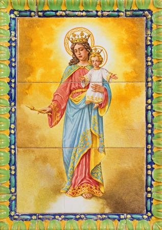 ceramica: SEVILLE, SPAIN - OCTOBER 29, 2014:  The ceramic tiled Madonna in the church Basilica del Maria Auxiliadora by A. Morilla from 20. cent. in manufactory Ceramica Santa Ana de Triana.