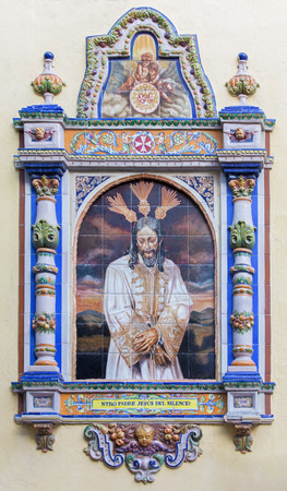 SEVILLE, SPAIN - OCTOBER 29, 2014: The ceramic tiled Christ in the bond by from 20. cent. by artist Enrique Orce Marmol on the facade of church Iglesia San Juan de la Palma.