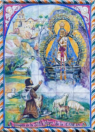 marmol: SEVILLE, SPAIN - OCTOBER 29, 2014: The ceramic tiled Madonna (Virgen de la Cabeza) from 20. cent. by artist Enrique Orce Marmol on the facade of church Iglesia San Juan de la Palma.